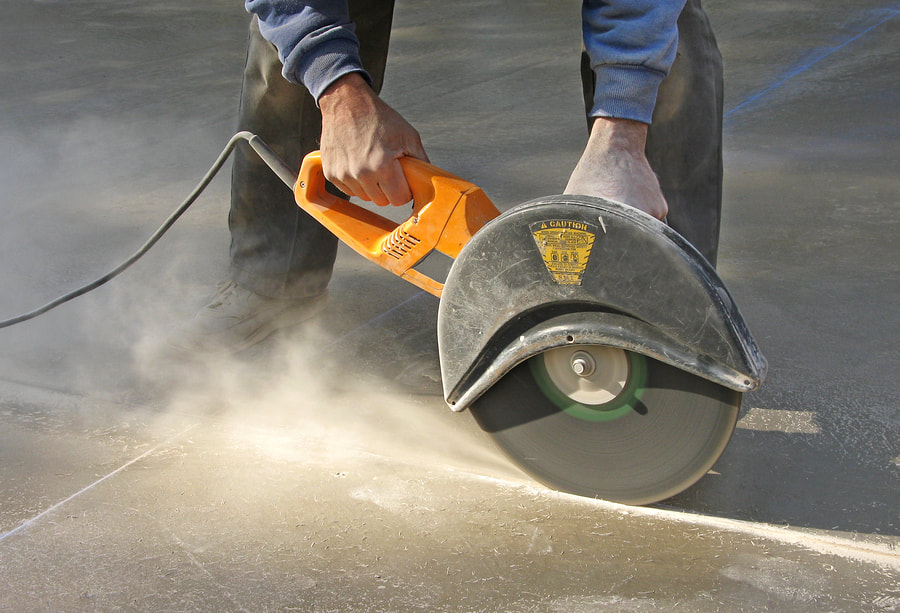 construction worker doing concrete cutting